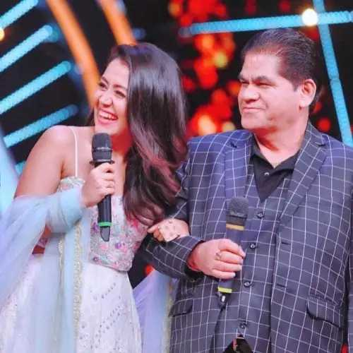 This image has an empty alt attribute; its file name is Neha-Kakkar-Father.jpg