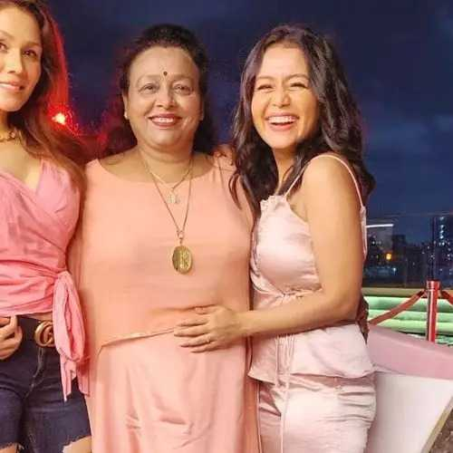 This image has an empty alt attribute; its file name is Neha-Kakkar-Mother.jpg