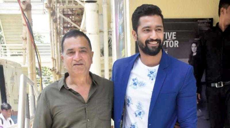This image has an empty alt attribute; its file name is Vicky-Kaushal-with-his-father-Shyam-Kaushal.jpeg